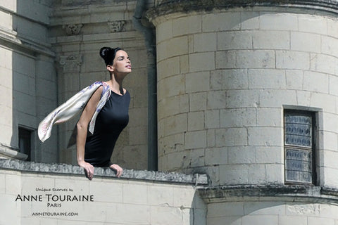 Paris New York scarf, silk, beige color by ANNE TOURAINE Paris™ tied around the shoulder for a romantic look
