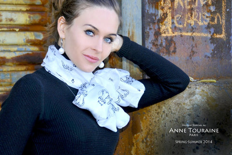 cat patterned silk scarves by ANNE TOURAINE Paris™: pale grey scarf tied around the neck with a fluffy bow