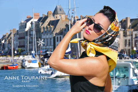 French silk scarves by ANNE TOURAINE Paris™: Zodiac inspired yellow scarf tied as a head scarf à la Jackie Kennedy
