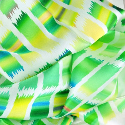 Green and yellow extra large silk scarf with a contemporary ethnic pattern: versatile and easy to wear all year round. Scarf ANNE TOURAINE Paris™ (5)