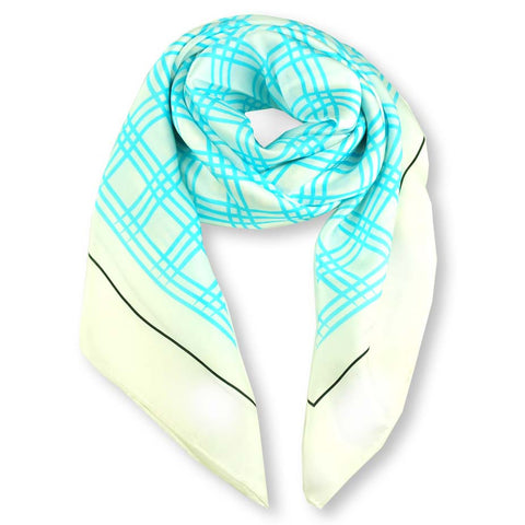 Turquoise and white extra large silk scarf with a fresh and modern stripe pattern: versatile and easy to wear all year round. Scarf ANNE TOURAINE Paris™ (1)