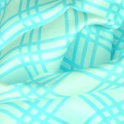 Turquoise and white extra large silk scarf with a fresh and modern stripe pattern: versatile and easy to wear all year round. Scarf ANNE TOURAINE Paris™ (5)
