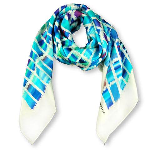 Turquoise and navy blue extra large silk scarf with a contemporary ethnic pattern: versatile and easy to wear all year round. Scarf ANNE TOURAINE Paris™ (1)