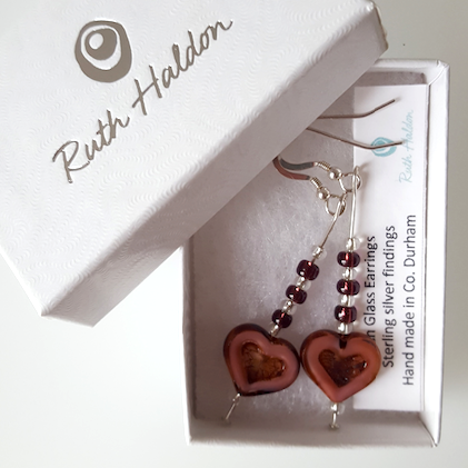 Dusky pink glass heart hook earrings.