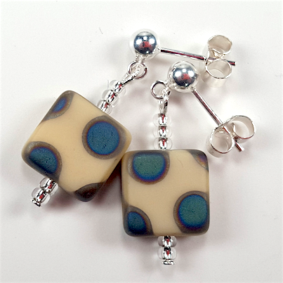 Cream spot post earrings