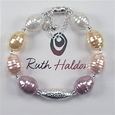 Pastel shades shell & silver bracelet