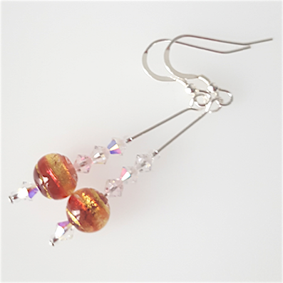 Orange/golden swirls Murano hook earrings
