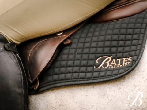 Bates Saddles saddle cloth and rider leg.