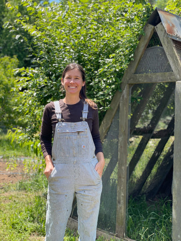 Mandy in front of her guinea fowl coop at 3 Porch Farm