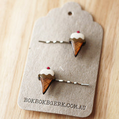 Hand painted laser cut wooden hairclips by Bok Bok B'Gerk