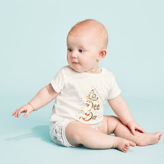 The cool La Dee Dah baby tee features a gold foil hand illustrated print on 100% cotton.