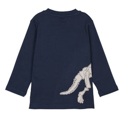The triceratops applique wraps around the side of this top from front to back.
