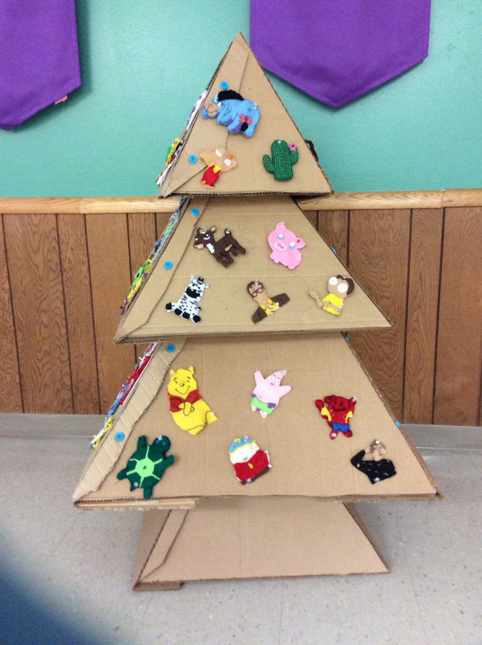 Hand sewn LED ornaments on cardboard Makedo Christmas tree