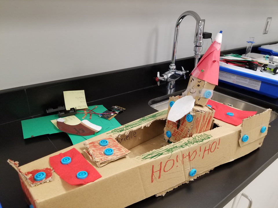 Cardboard Santa in his cardboard Makedo sleigh