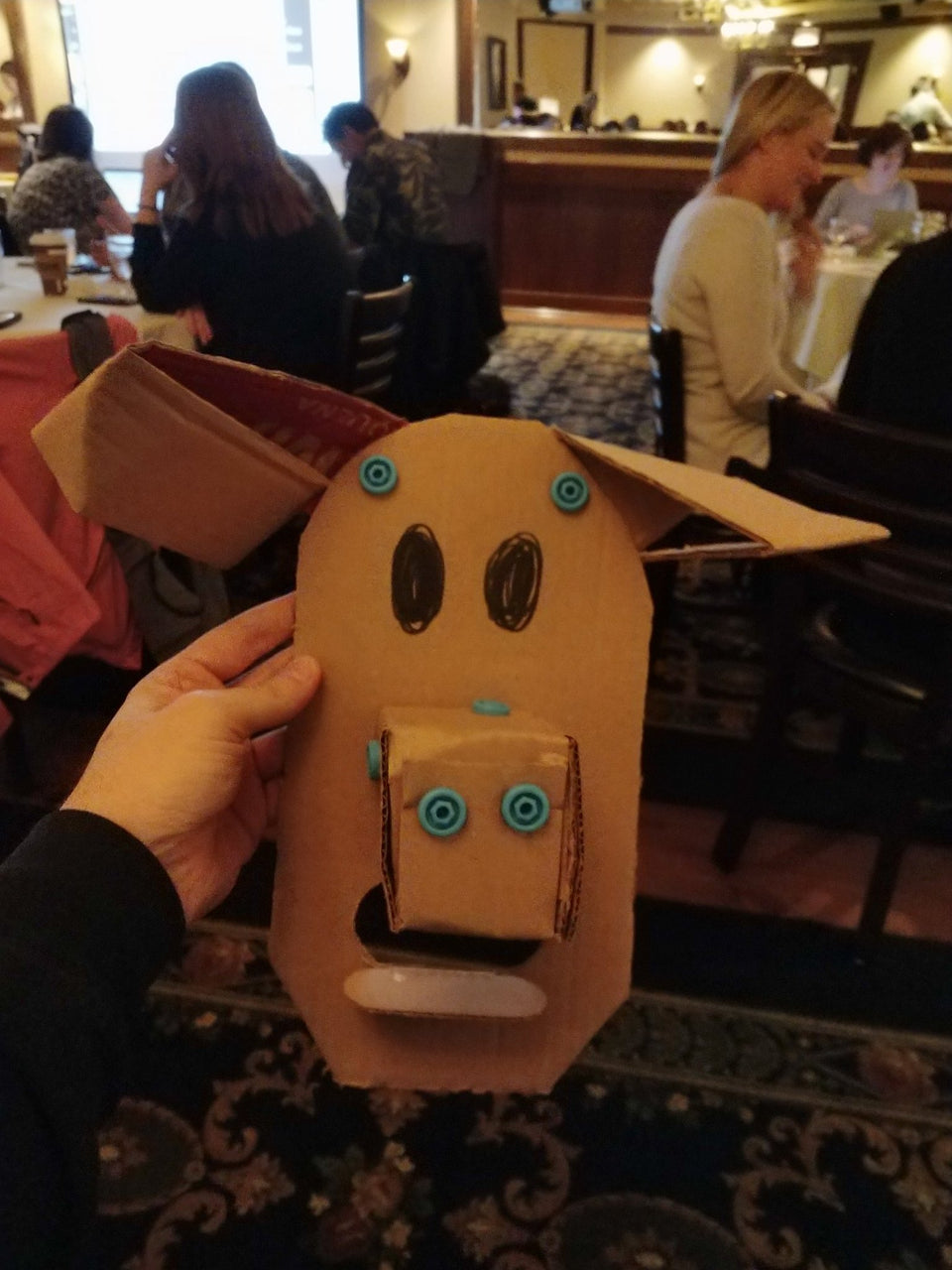 Makedo cardboard pig mask that started as a dog