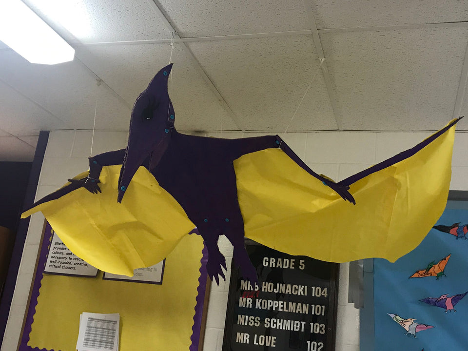 Cardboard pterodactyl made using Makedo cardboard construction system