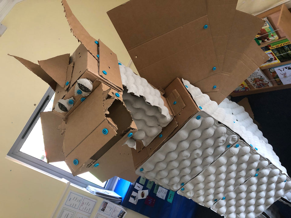 Giant cardboard dragon built with cardboard egg crates and Makedo construction system