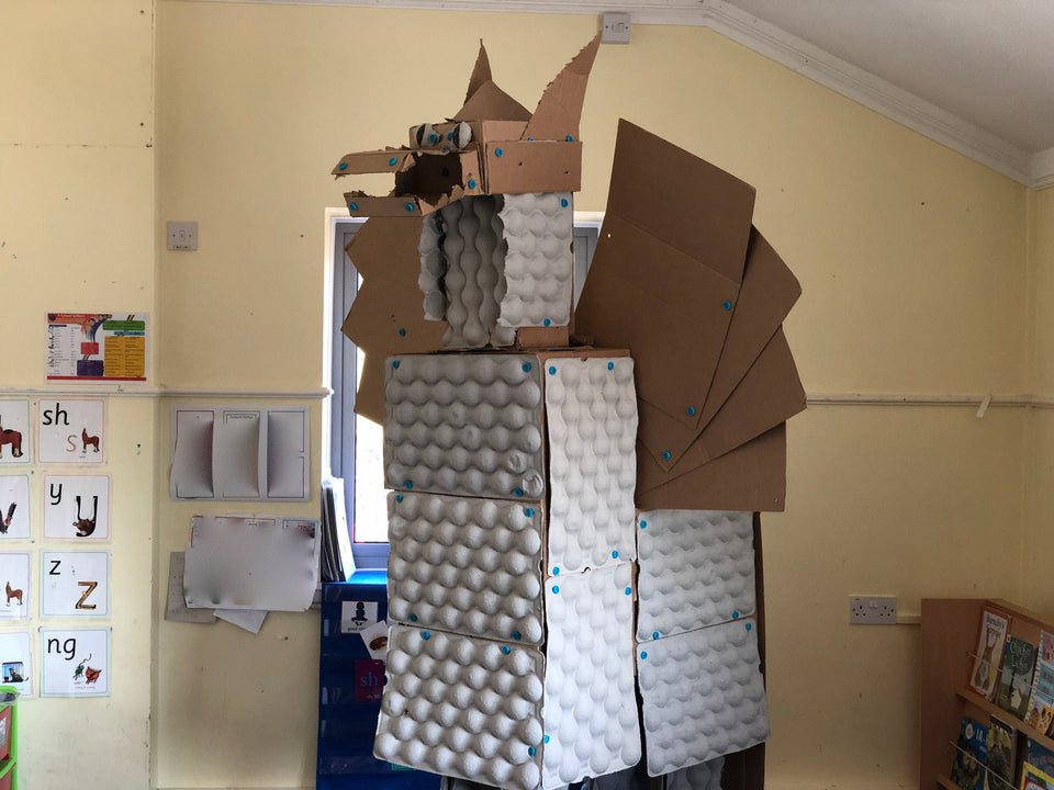 Giant cardboard dragon built with cardboard egg crates and Makedo