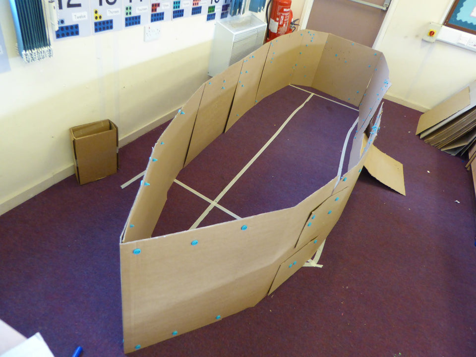 Construction in progress for a Makedo cardboard pirate ship