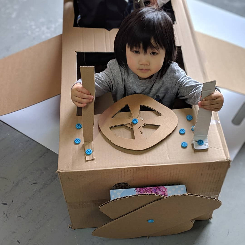 Pilot ready, where are we heading to in this Makedo cardboard plane?