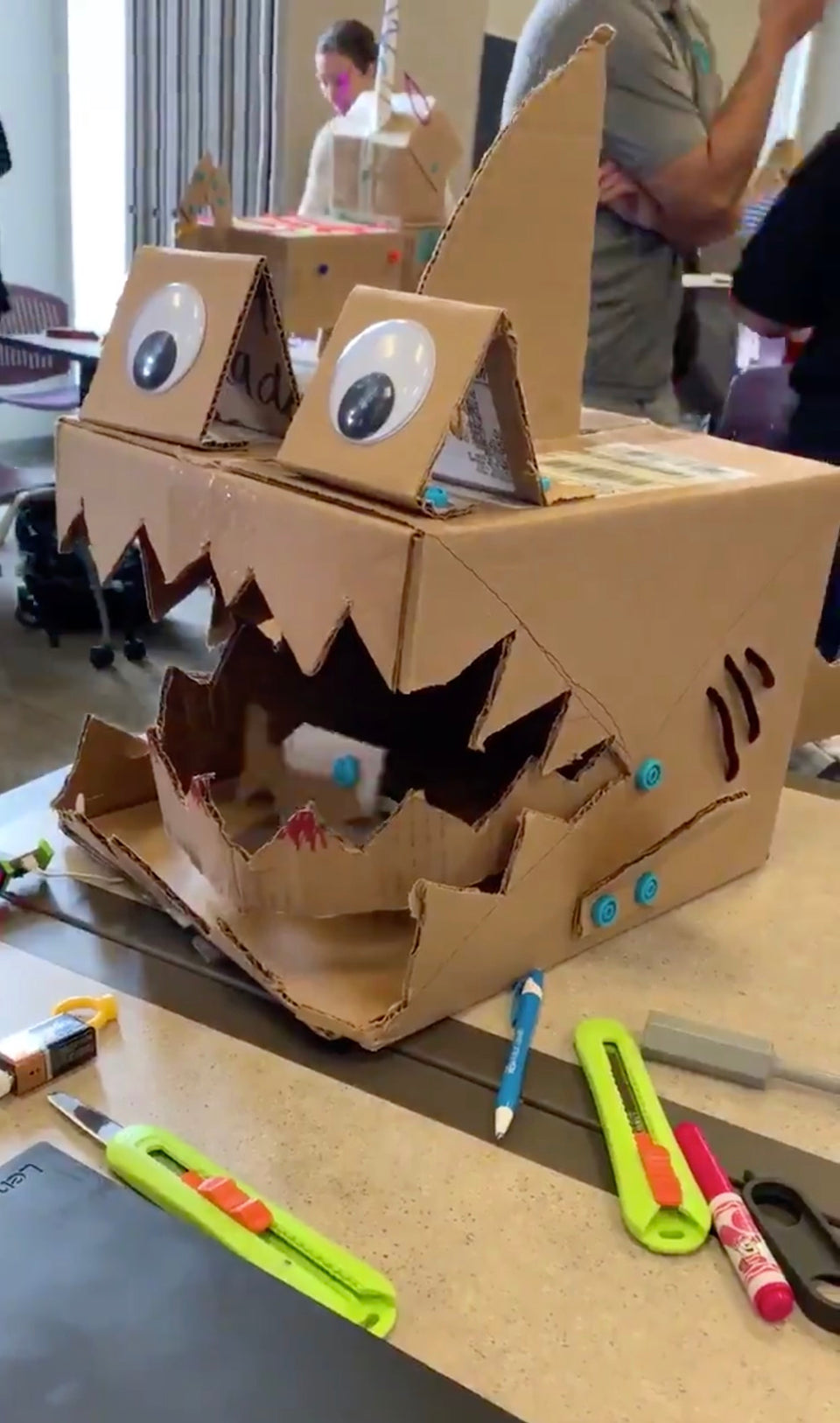 Makedo cardboard shark with littlebits animated fish inside its mouth.