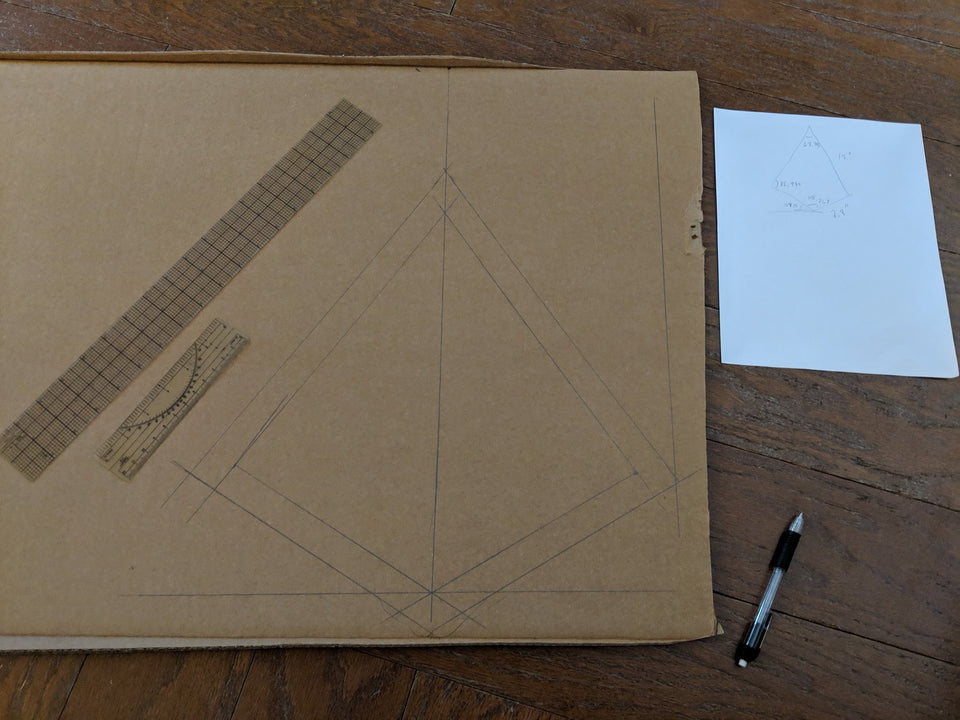Mapping out parts for the cardboard geo dome to build with Makedo construction tools