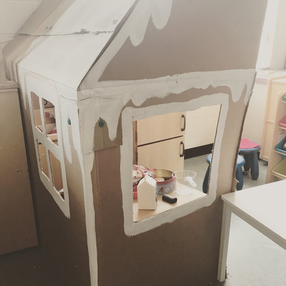 Cardboard gingerbread playhouse built using the Makedo cardboard construction system