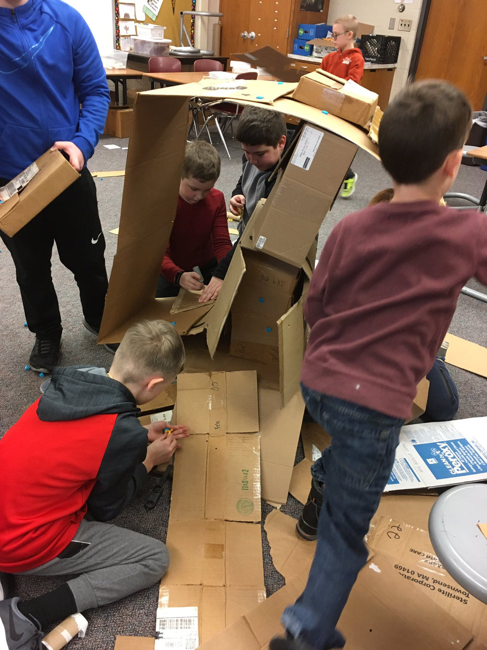 Building the tallest cardboard tower with Makedo tools.