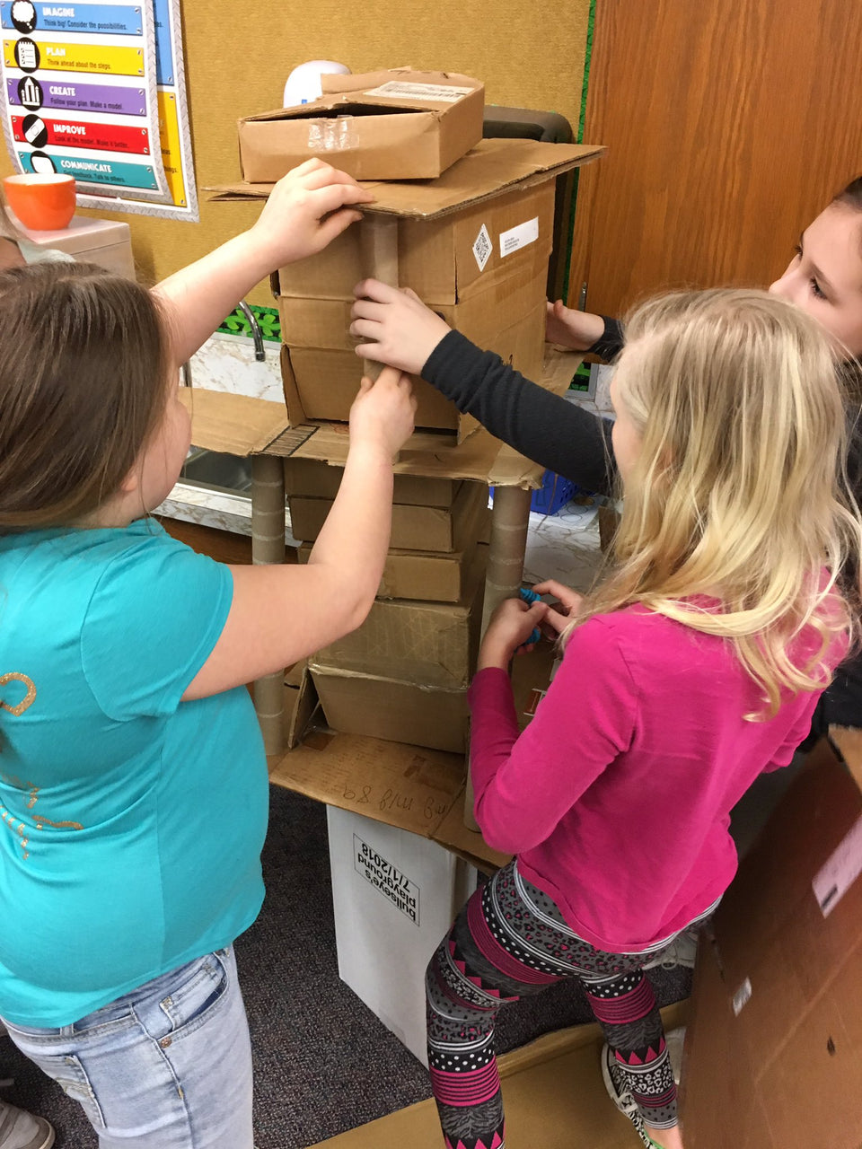 Cardboard challenge - which team can build the tallest tower with Makedo