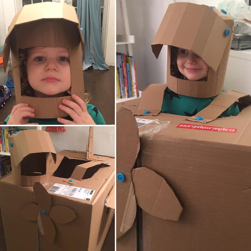 Wearable airplane costume using Makedo cardboard construction tools.