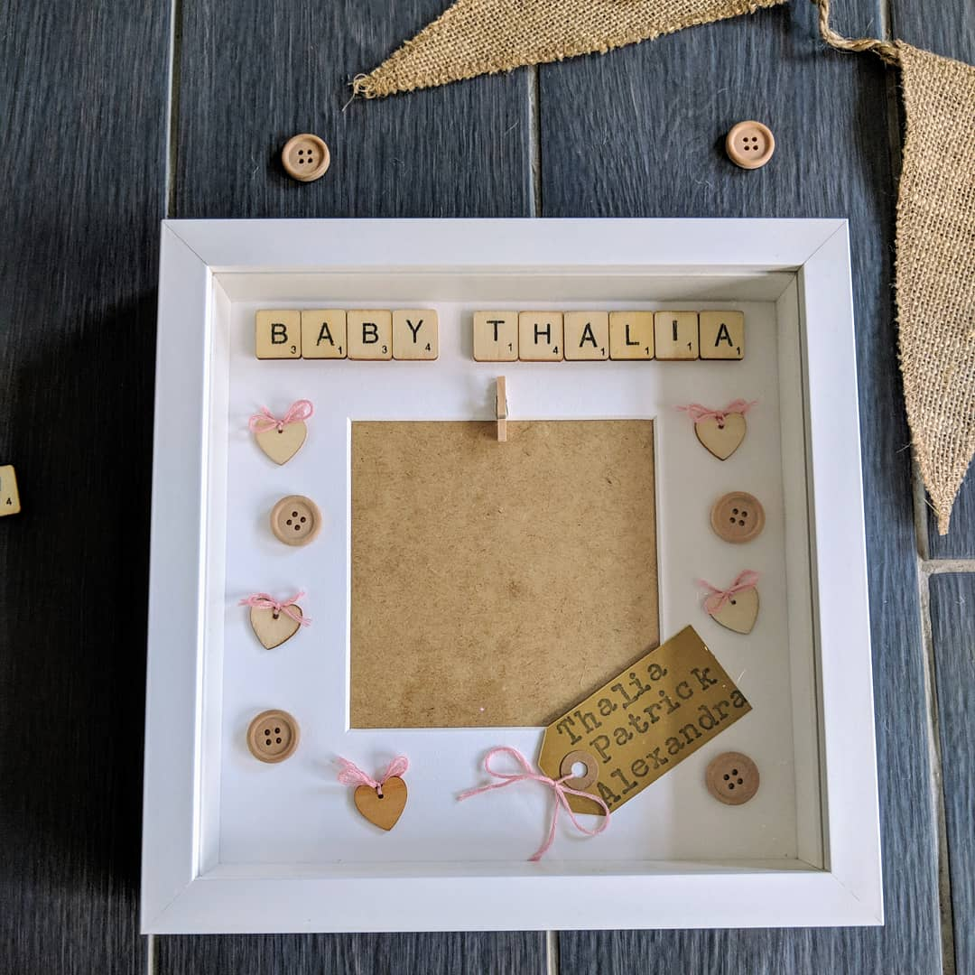 pink bows and wooden heart embellishment. Scrabble tiles frame available in black or white