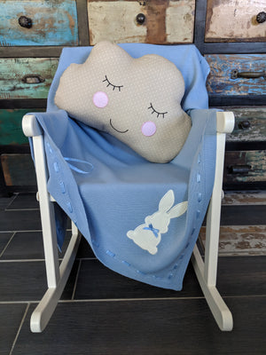 scandi style nursery decor, decorative cloud shaped cushions available in greige and white. Complete with happy face motif