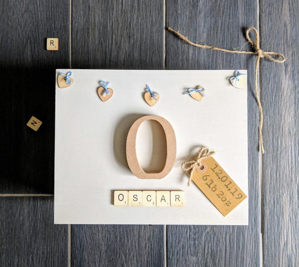 handmade wooden memory box with wooden initial and heart embellishments. Scrabble letter name and kraft tag keepsake box