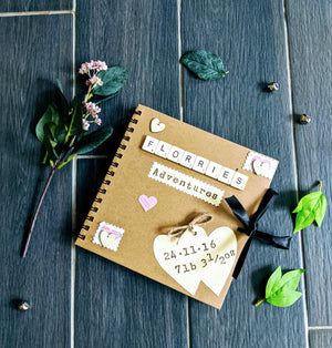 Hand crafted memory book, 60 kraft pages to filled with photos and keepsakes. Scrabble tiles spell any name, baby journal to record milestones.