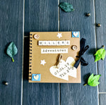 Hand crafted memory scrapbook, 60 kraft pages to filled with photos and keepsakes. Scrabble tiles spell any name, baby journal to record milestones.