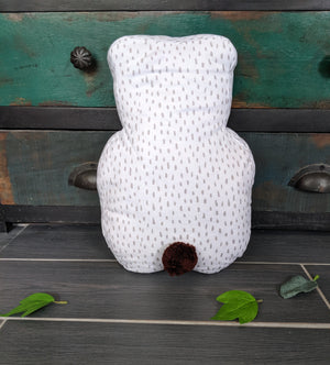 scandi style decorative cushion with bear motif and pom pom tail, beautiful neutral colours for the perfect addition to any girl or boy's room