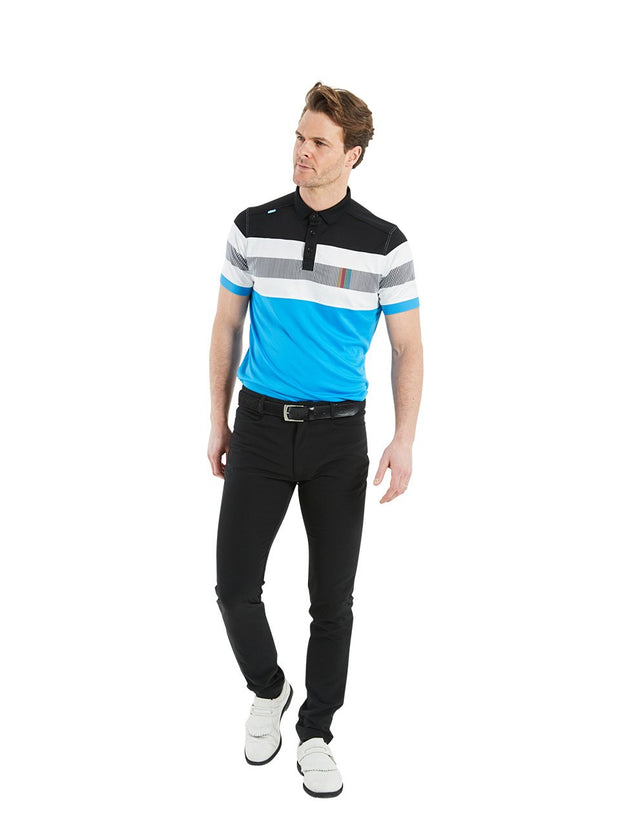 Bunker Mentality Switch Blue Stripe Mens Golf Shirt. Solid Blue Bottom half with White and Black Stripes at top - Model Wearing Black Trousers
