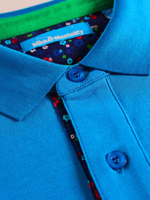 Bunker Mentality Blue Mens Cotton Golf Shirt with floral print to inner placket - close up