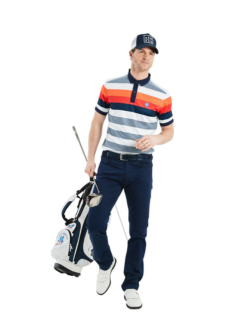 Bunker Mentality Navy and Orange Bold Stripe Mens Golf Shirt - Model Wearing Navy Golf Trousers