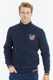 Bunker Mentality Navy full zip mens layer golf top with bunker shield on chest - Model