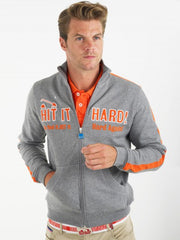 Bunker Mentality grey full zip mens golf lifestyle top with hit it hard in orange - model