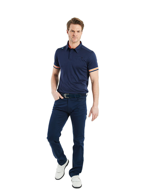 Bunker Mentality Cmax Navy Mens Golf Shirt with contrast orange and White tipping - Model Wearing Navy Golf Trousers