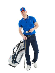 Bunker Mentality Electric Blue Mens Golf Polo Shirt with Four Pinstripe Contrast tipping on sleeves and collar - Model Wearing Navy Golf Trousers