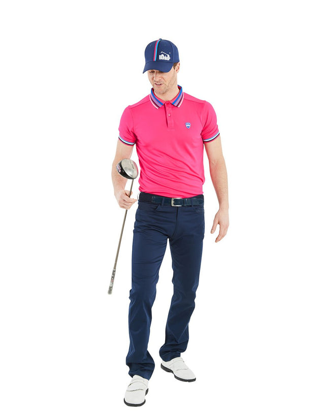 Bunker Mentality Pink Mens Golf Polo Shirt with Four Pinstripe Contrast tipping on sleeves and collar - Model Wearing Navy Golf Trousers