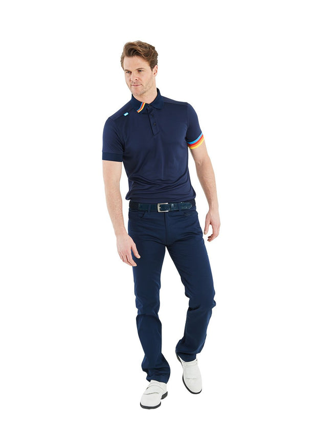 Bunker Mentality Kobi Navy Mens Golf Polo Shirt with Multi Colour Left Cuff and Detail on Collar - Model Wearing Navy Trousers