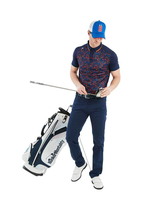 Bunker Mentality Navy Golf Shirt with Orange Paisley Print Golf with Solid Navy Arms - Model Shot Wearing Navy Golf Trousers
