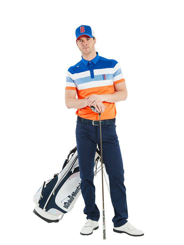 Bunker Mentality Switch Orange Stripe Mens Golf Shirt. Solid Orange Bottom half with White and Blue Stripes at top - Model in Navy Golf Trousers