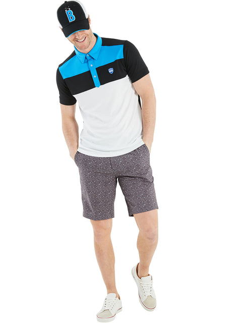 Bunker Mentality Cmax Leon Mens Golf Polo Shirt with Deep Bunker Blue and Black Panels on Top Quarter - Model Wearing Kade grey Shorts