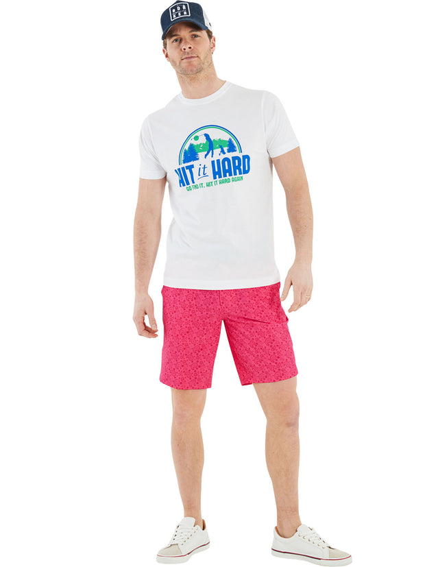 Bunker Mentality Scenic Hit It Hard Graphic Print White Green Mens Golf T Shirt - Model wearing Kade Pink Shorts