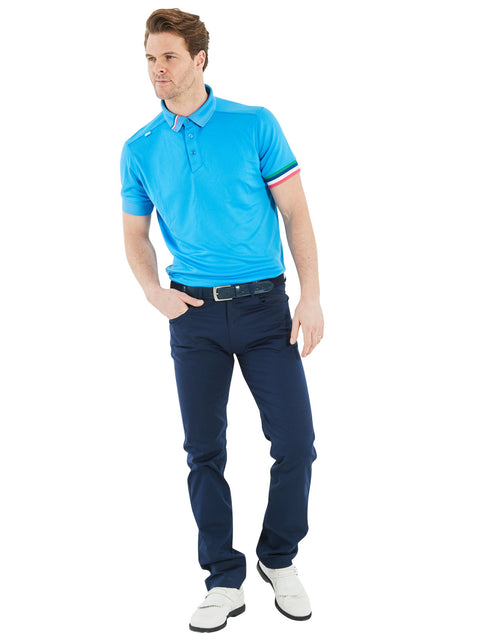 Bunker Mentality Kobi Solid Bunker Blue Golf Polo Shirt on model wearing Rox Navy Golf Trousers